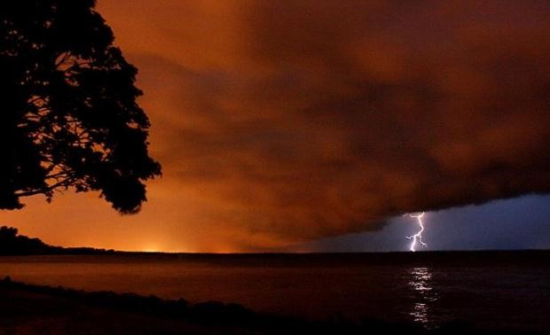 lightning strike with red sky