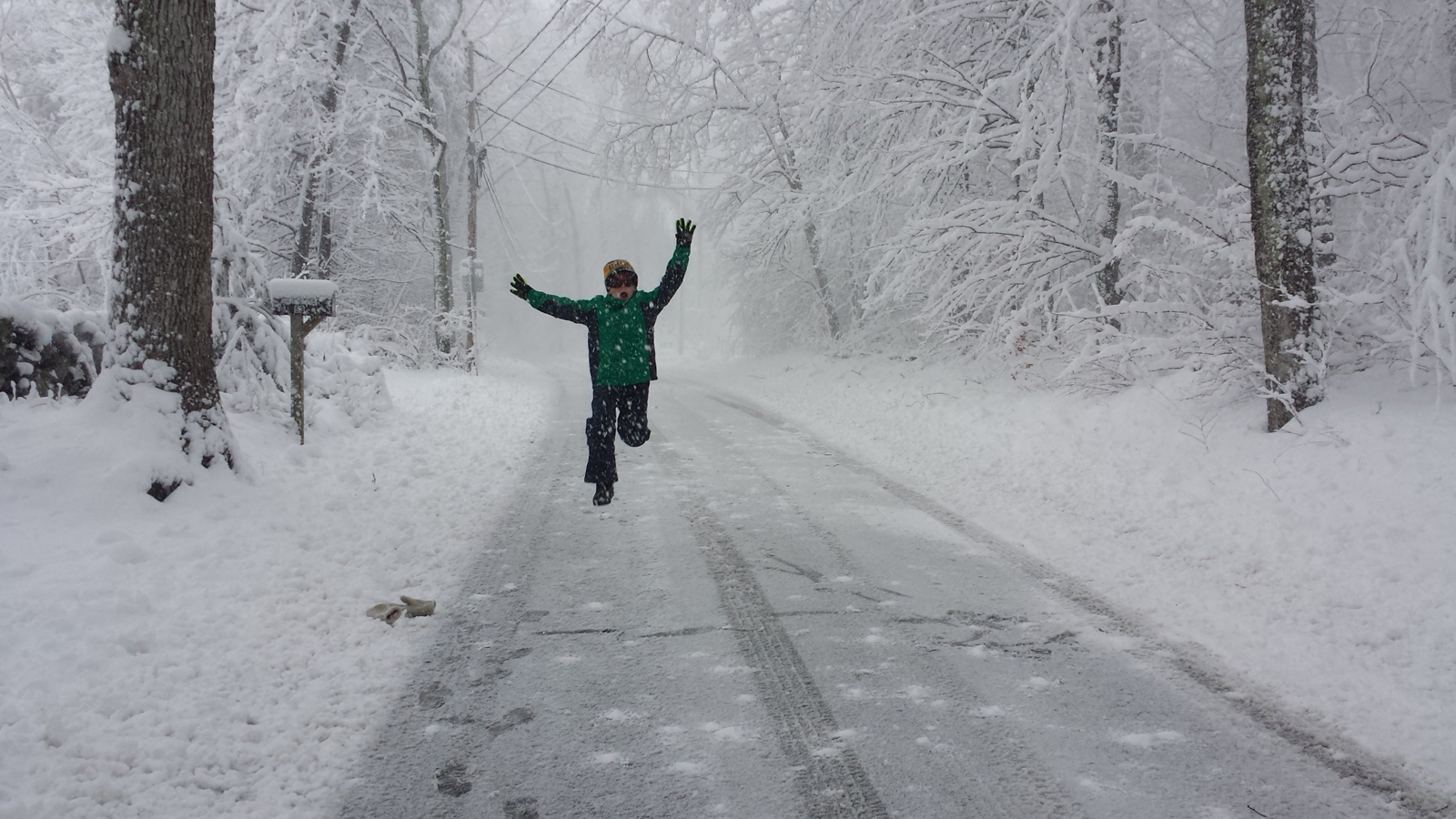 child running through snowy street