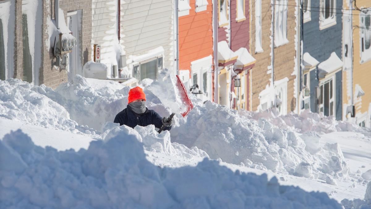 man shoveling snow outside