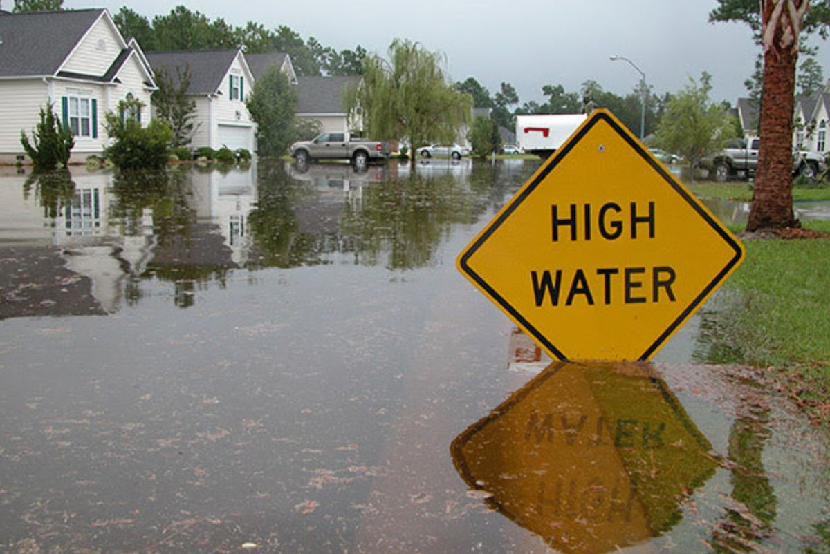 High Water sign in flooded street, courtesy of NOAA