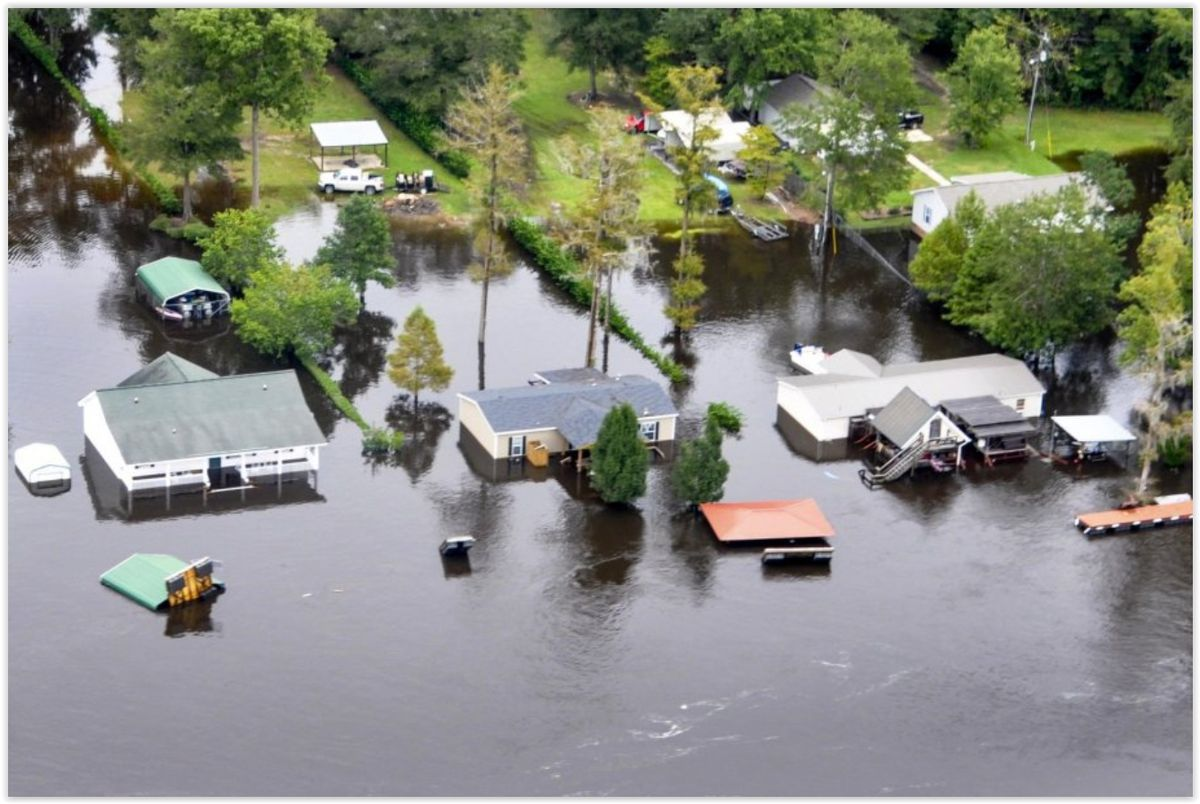 Flooded community from the air. Image via US Coast Guard